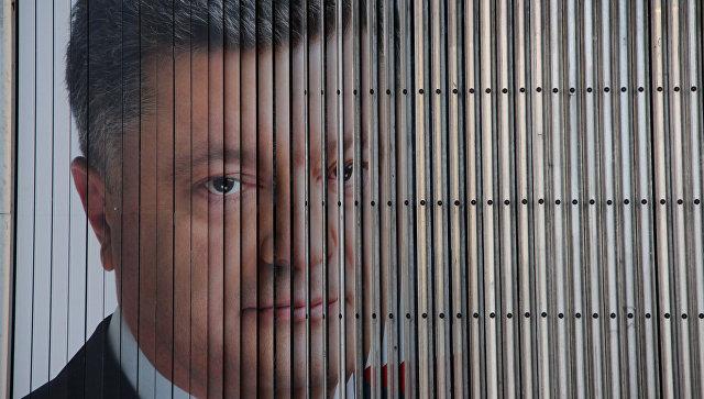 На предвыборных плакатах Порошенко снова появился Путин